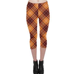 Orange Orange And Brown Cross Pattern Capri Leggings by CoolDesigns