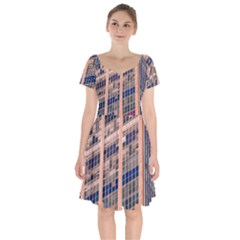 Low Angle Photography Of Beige And Blue Building Short Sleeve Bardot Dress
